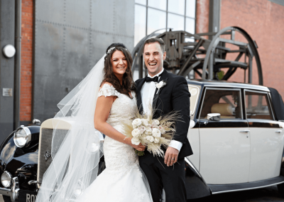 bride and groom outside the titanic hotel wedding venue vintage wedding car liverpool merseyside uk