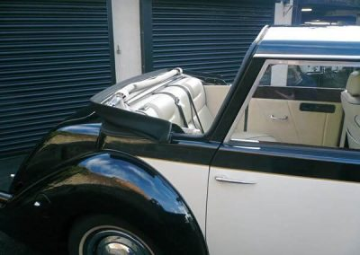 Royale Windsor wedding car rear roof down in barringtons wedding cars yard waiting to go out on a wedding
