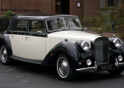 Royale Windsor vintage wedding car outside church in Rainhill liverpool Merseyside wirral