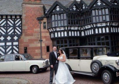Bride and groom with the imperial viscount Landaulette vintage wedding car outside hillbark Hotel wedding venue wirral Liverpool Merseyside UK