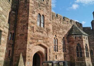 peckforton castle wedding venue with a imperial viscount vintage wedding car outside