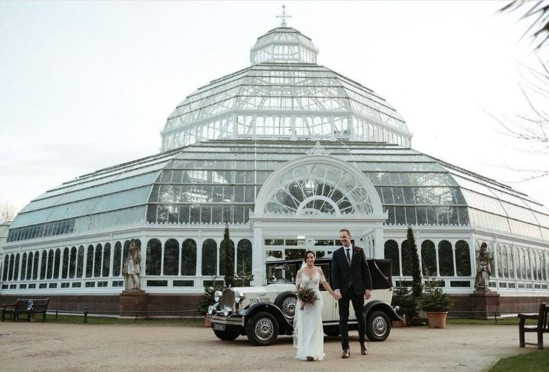 vintage wedding car outside the palm house sefton park with the tallest groom we have ever had